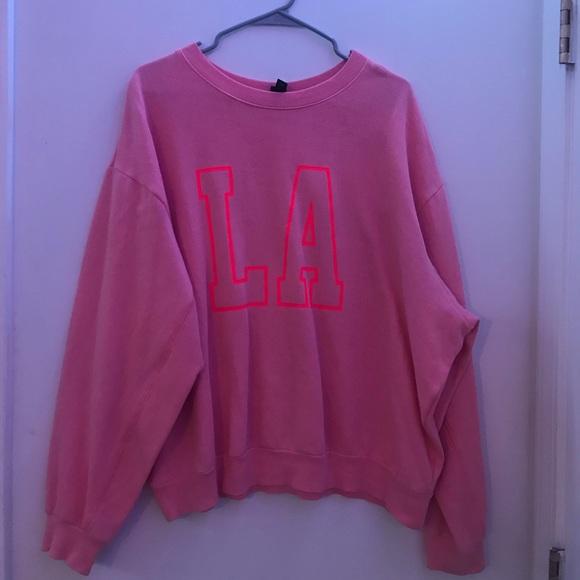 Pink L.A. sweatshirt.